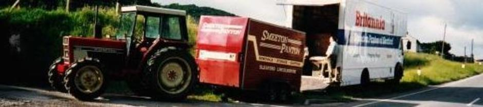 Britannia Smeeton Panton removals of lincolnshire tractor moving a trailor
